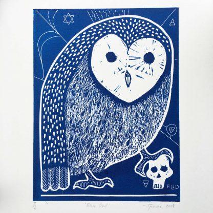 stylised blue owl with human skull and pagan symbols lino print art